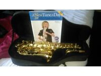 Alto saxophone with stand and beginners book