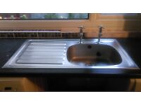 Single kitchen sink with individual hot and cold taps