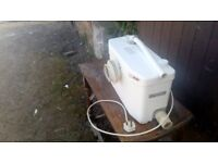 Saniplus macerator unit. Previously used. Good working order. Toilet and 2 other inlets. 240 volt.