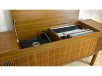 Vintage record player cabinet with records