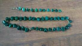 Jade neclace and bracelet with gold coloured links designer