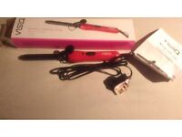 Brand new visiq curling tongs .