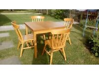 Oak effect dining table 90 cm square extending to 160cm,comes with 4 chairs.