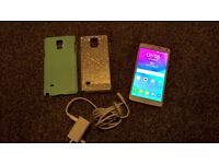 Samsung Galaxy Note 4, c/w original charger, 2 cases, no box. Slight faulty issue (see description)