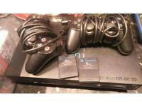 PlayStation 2 + 2 controllers + 22 games + 2 memory cards