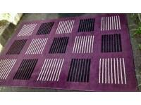 PURPLE SHADED SQUARE PATTERNED RUG MEASUREMENTS ARE APPROXIMATE 160 cm x 220cm