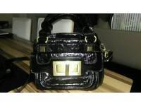 Dune black patent handbag