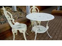 Metal garden table and 2 chairs excellent condition
