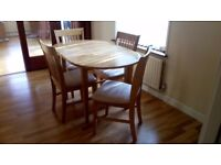 Beech Dining table & 4chairs in neutral faux covers good condition