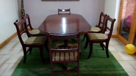 DINNING TABLE AND SIX CHAIRS .