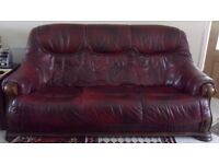 Brown leather 3-seater sofa.
