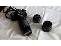Nikon Em SLR camera and lenses