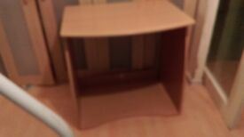 a small assembled computer desks