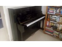 Eavestaff upright piano. Black polished finish. Good condition, well-maintained