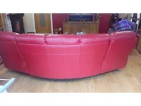 Red leather reclining curved sofa