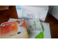 Wii console with Wii fit board and EA Sports Active Personal Trainer