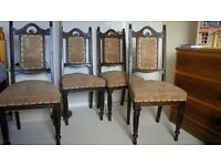 Four old dining chairs