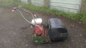 Webb lawn mower with roller seat