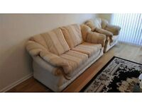 Gold two piece suite-three seater and chair