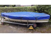 12ft Witt Rowing / Fishing boat with combined launch/tow trailer in good condition.
