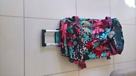 Maiseemoo large soft travel bag on wheels.
