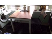 Dinner Table with a set of 4 folding chairs