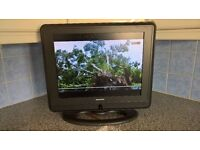 "19"" Digihome TV, with remote control."