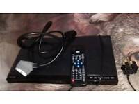 Dvd player with scart lead and remote control