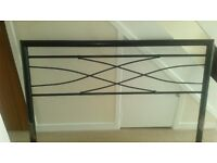 Double bed frame. Standard size. Black metal finish. Wooden slats.