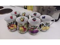 Set of seven china mugs with fruit designs