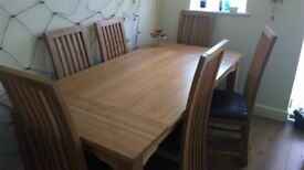 Solid oak dining table with 6 winchester chairs