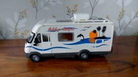 A likable Campervan Toy with movable bits and accessories in Excellent Condition