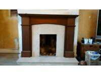 Marble hearth with wooden surround