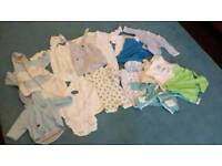 New born bundle of baby boy's clothes