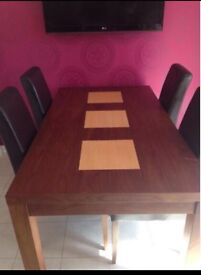 Dining room table and 6 brown faux leather chairs