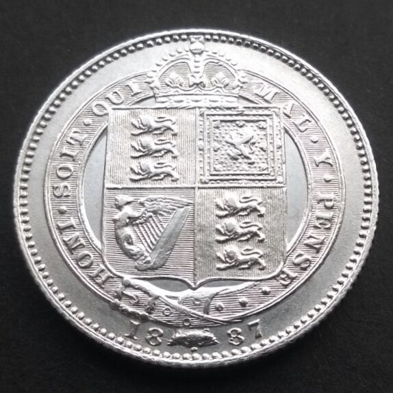 This Victorian Shilling, dated 1887, was stained brown and black before cleaning. You could hardly see it.
