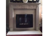 Two electric fan fires with granite back/hearth and wooden surround