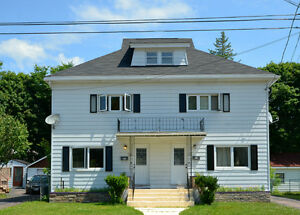SPACIOUS UPDATED SIDE BY SIDE DUPLEX WITH DETACHED GARAGE!