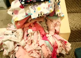 A big bundle of baby clothes