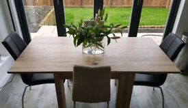 Next folding dinning room table and four chairs
