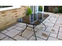 PATIO TABLE, FOUR STACKABLE CHAIRS AND PARASOLE