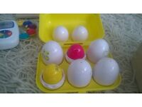 For Sale: 'Tomy' push up egg toy in box.