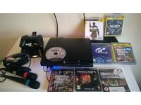 PS3 with karaoke set and 7 games FREE PS2 with steering wheel and 15 games