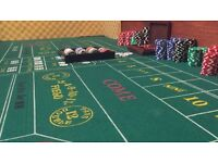 Craps table with poker chip set and card shuffler