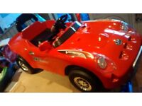 Electric ride on red roadster sports