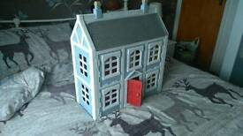 Offers pretty Dolls House