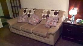 Comfy 3 piece suite with sofa bed, 2 armchairs, 1 is a recliner.