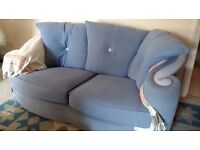 Comfy blue two seater sofa