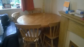 Beautiful large solid wood extendable dining table with 6 chairs, great condition