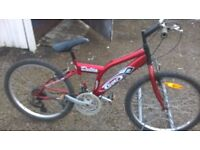mountain bike SUIT 7 TO 13 YEAR OLD HAS 24 INCH ALLOY WHEELS can be adjusted to suit
